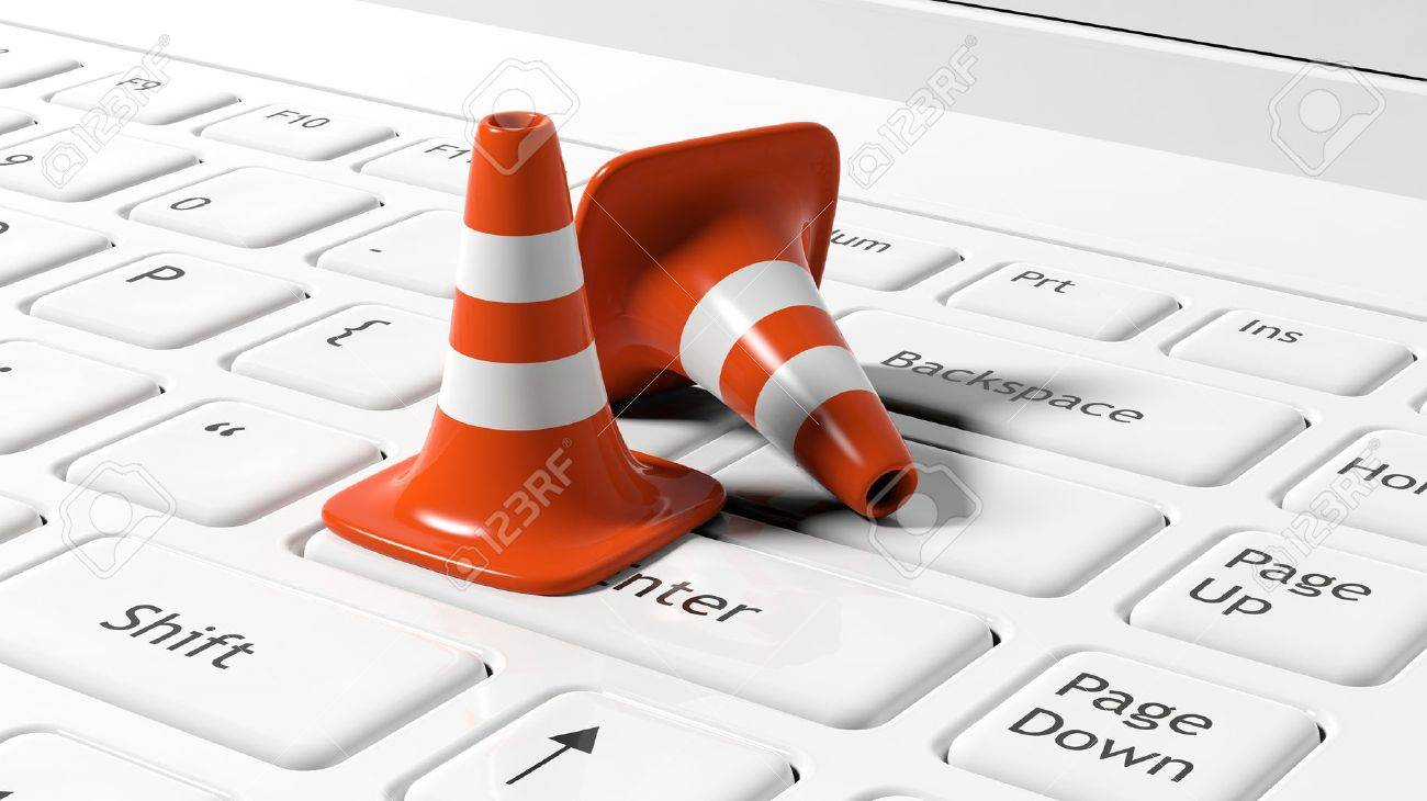 Orange traffic cones on white laptop keyboard - 41389890