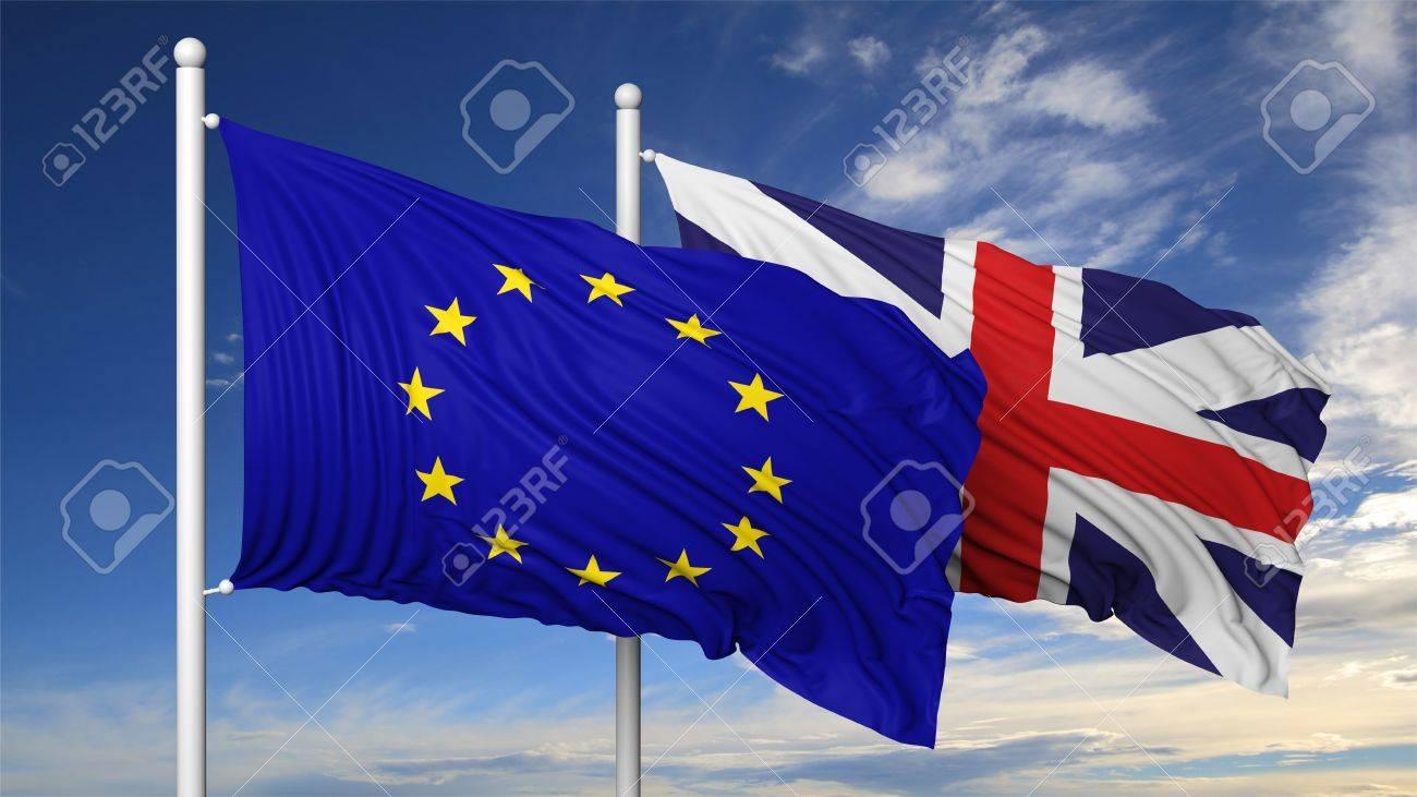 Waving flags of EU and UK on flagpole, on blue sky background. Stock Photo - 44876121
