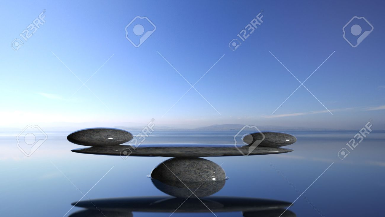 Balancing Zen stones in water with blue sky and peaceful landscape. Stock Photo - 50022802