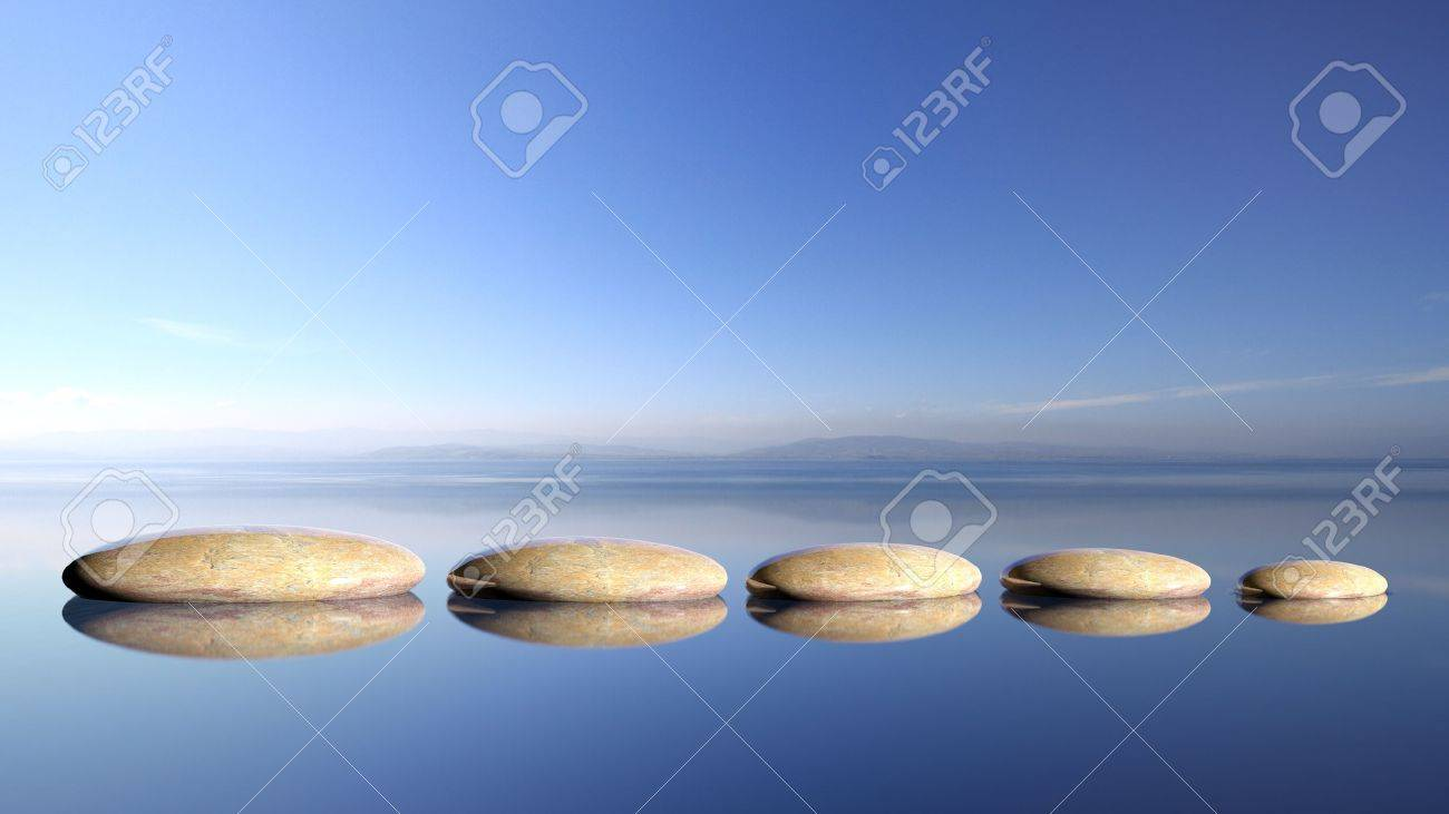 Zen stones row from large to small  in water with blue sky and peaceful landscape background. Stock Photo - 50022955