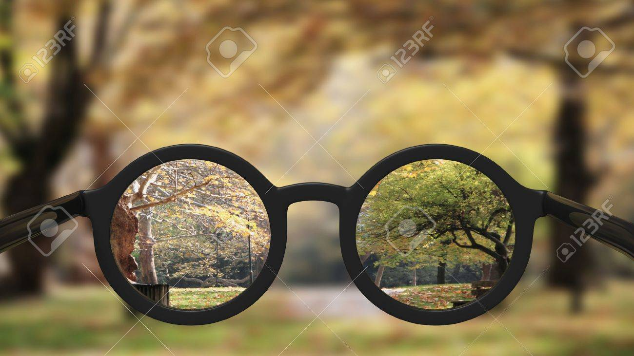 Closeup on eyeglasses with focused and blurred landscape view. Stock Photo - 52326030