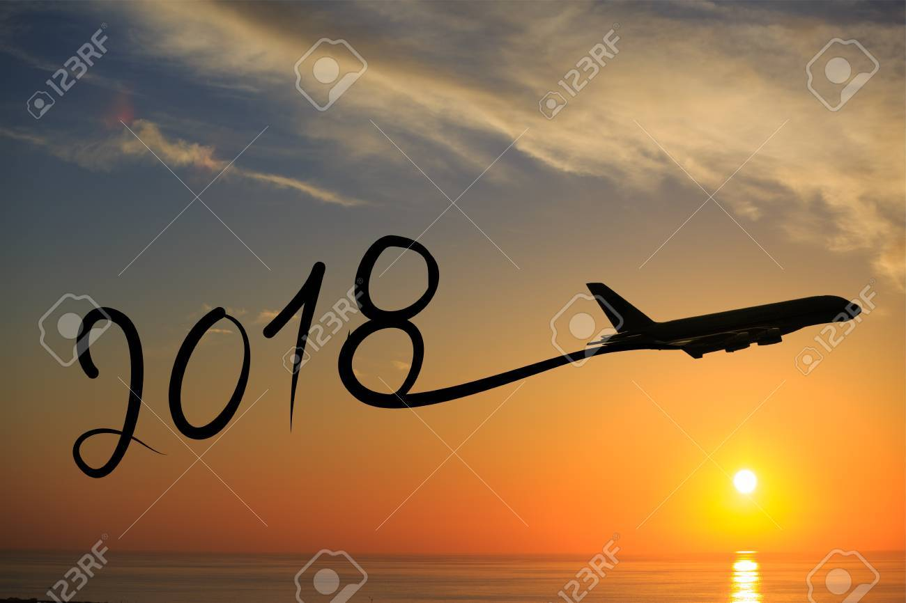New year 2018 drawing by airplane on the air at sunset Stock Photo - 89518787