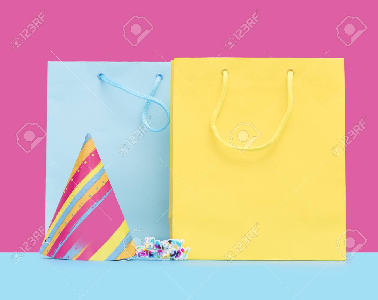 Cool Yellow And Blue Shopping Bags Birthday Hat Sticker In Front Of The Wonderful