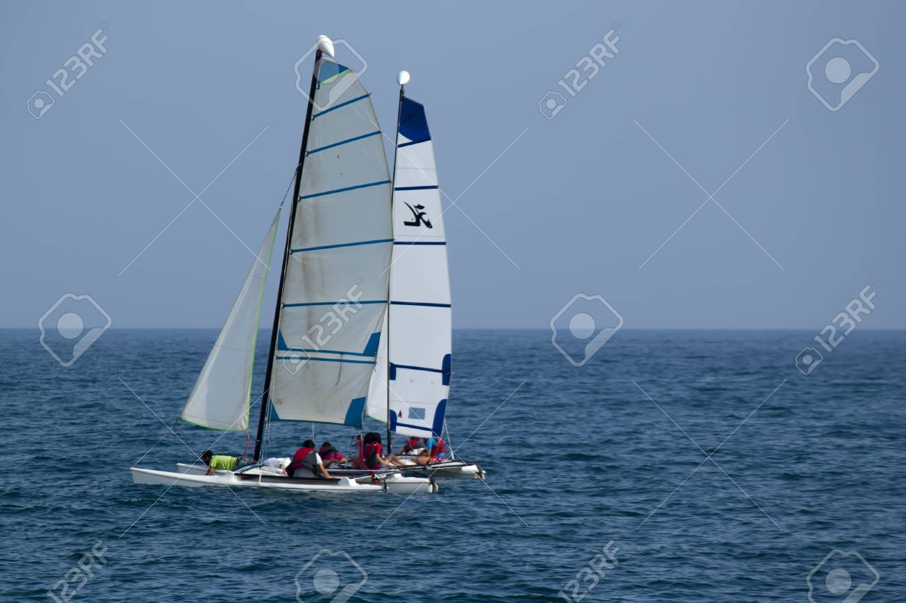 CALELLA, SPAIN - JULY 19, 2013  Catamaran sailing in the Mediterranean Sea in Calella on July 18, 2013  Every lover of sailing can ride on the Sea Stock Photo - 21487214