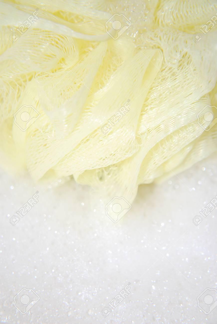 massage yellow bath sponge with water drops Stock Photo - 15757905