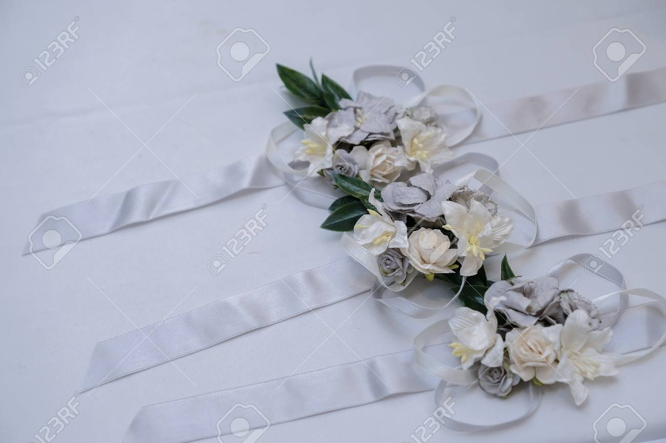 Little Flower Bouquet And Ribbon On White Table Stock Photo Picture