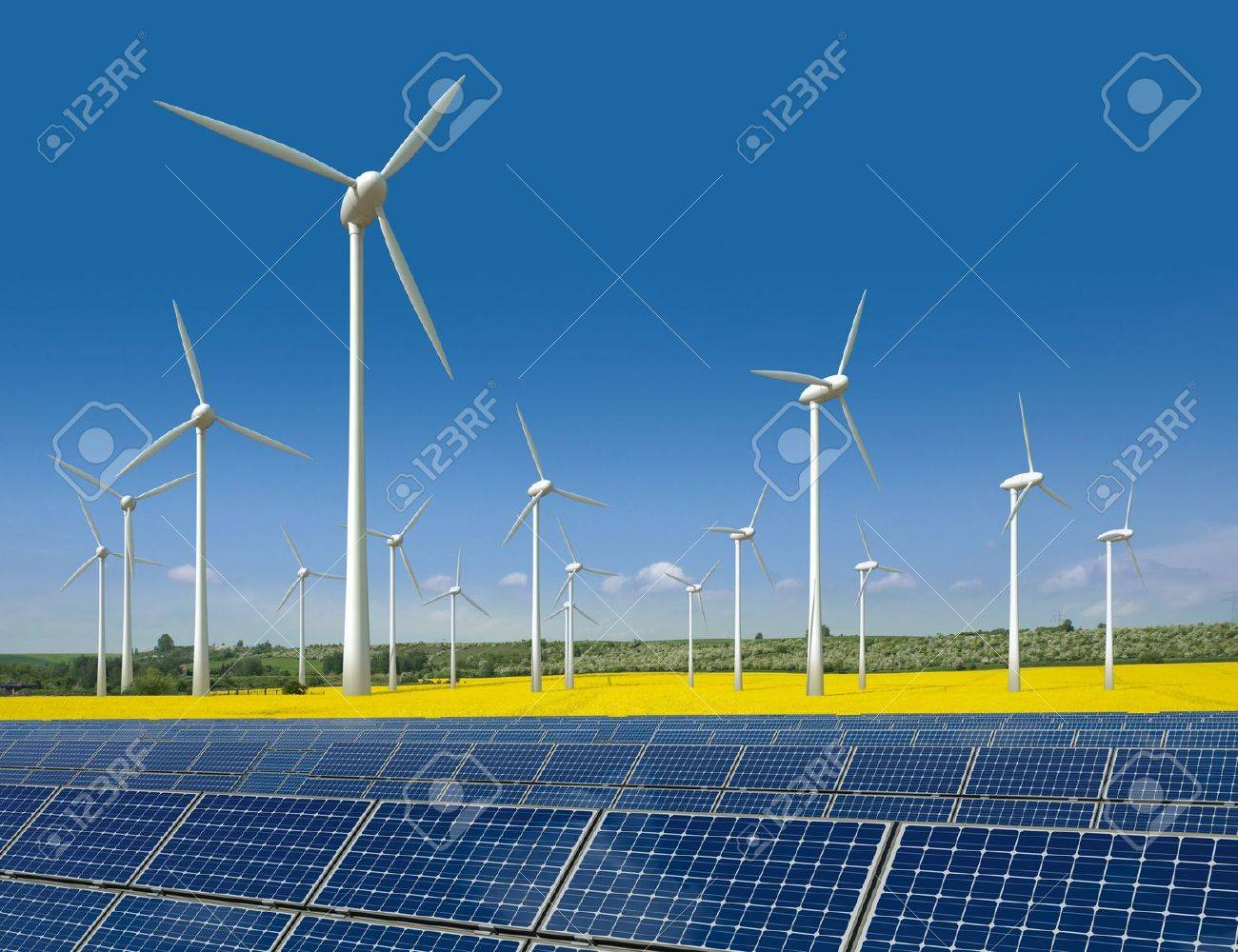 Wind turbines and solar panels in a rapeseed field - 10494635
