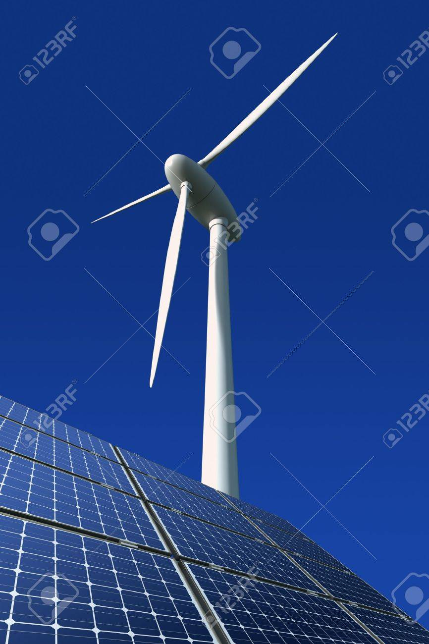 Solar panels and wind turbine against a blue background Stock Photo - 10726386