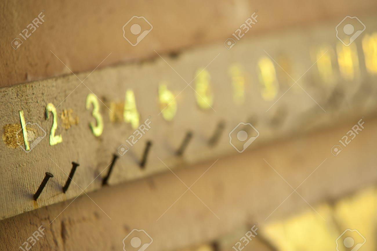 Old board with rusty nails and numbers Stock Photo - 11088687