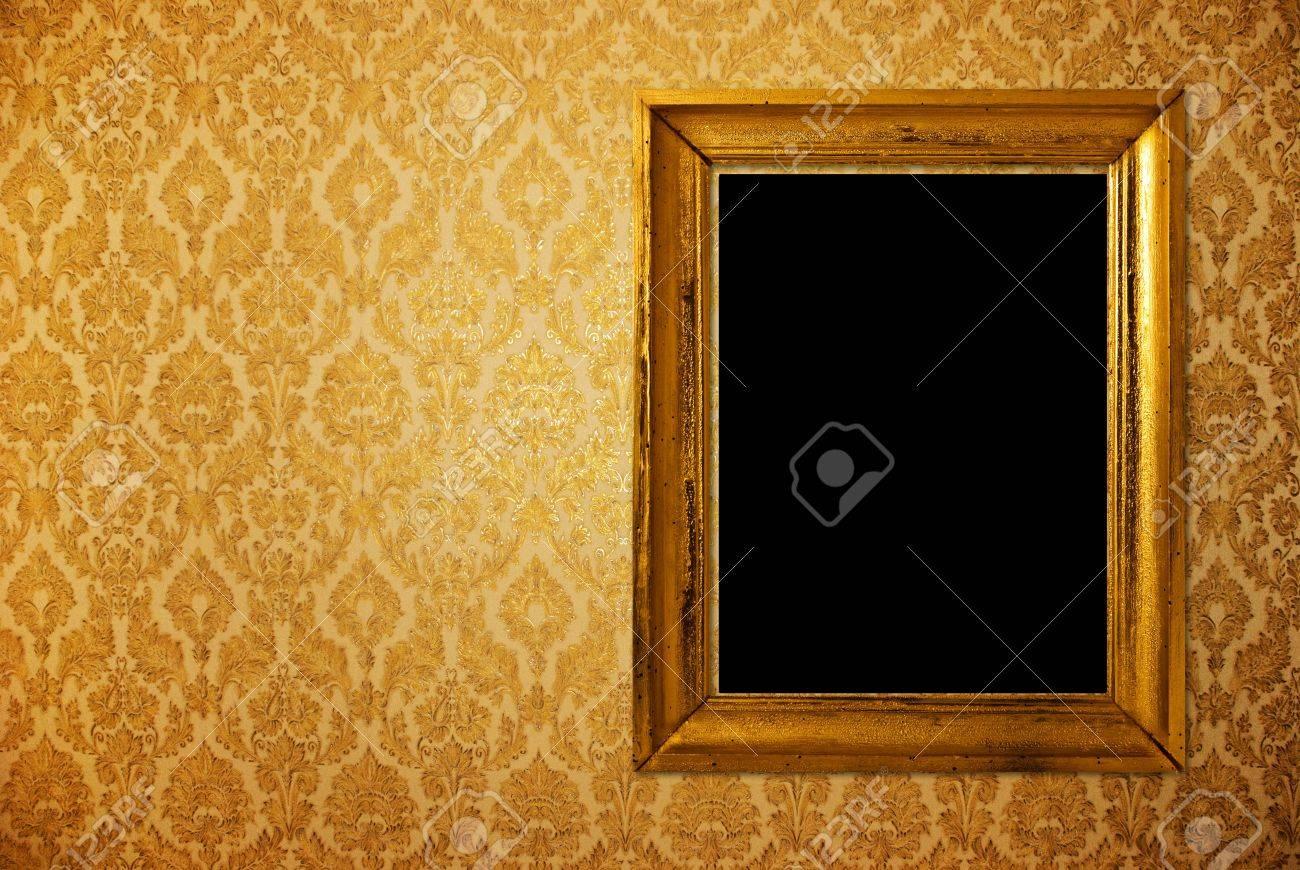 Vintage Frame Over Golden Wallpaper