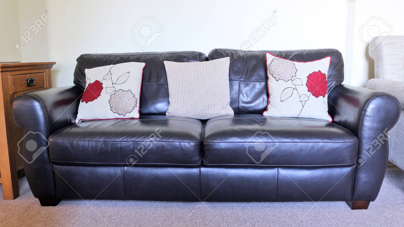 Two Seater Black Leather Sofa With Red Cushions Stock Photo, Picture ...