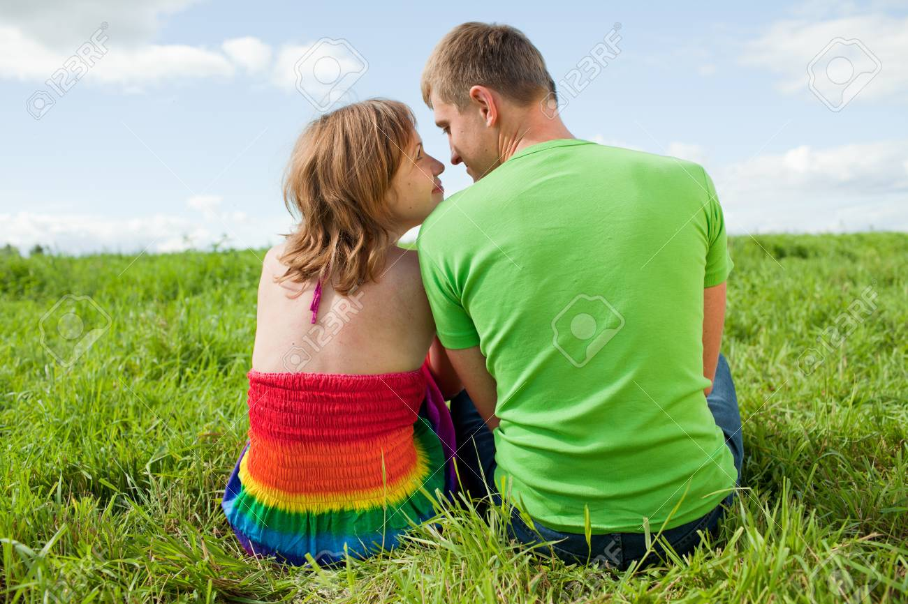 Couple on the grass looking at each other Stock Photo - 10233068