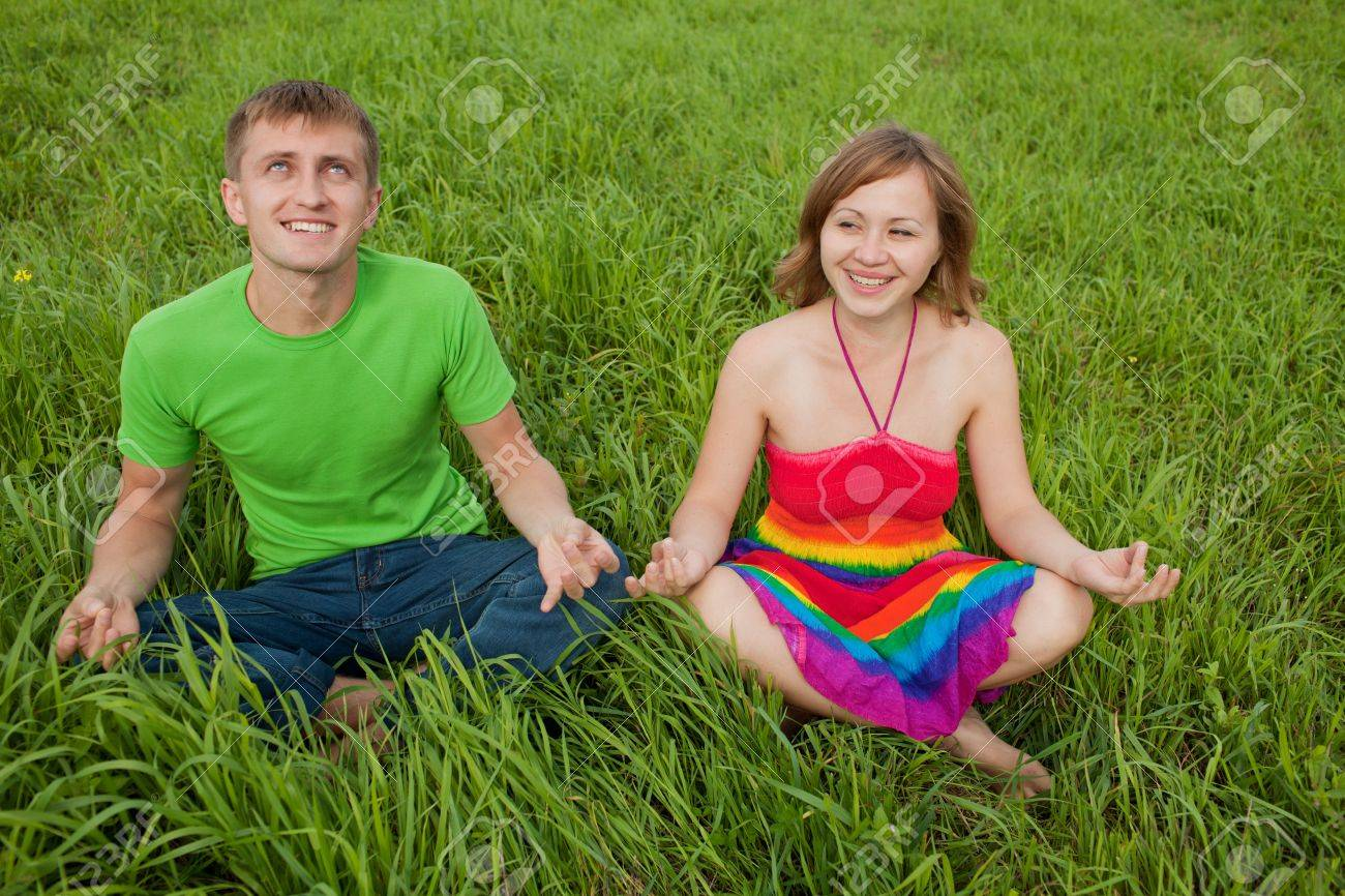 Couple on the grass and meditate together smiling Stock Photo - 10233072