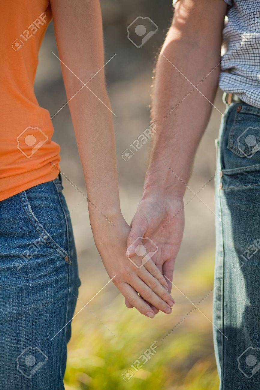 pair of hands that hold each other Stock Photo - 10439054