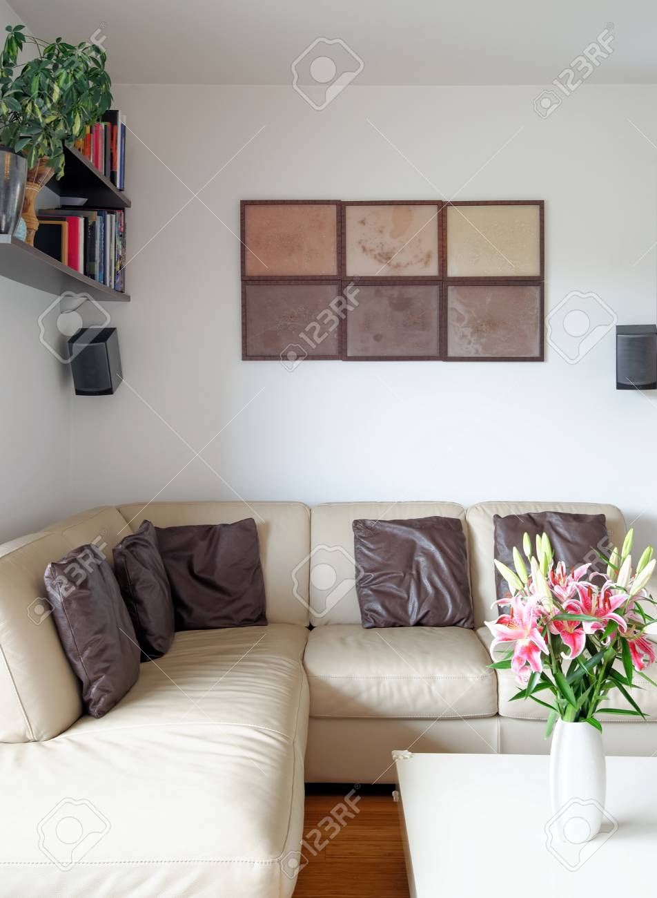 A Modern Living Room With A Table And Leather Sofa Stock Photo ...