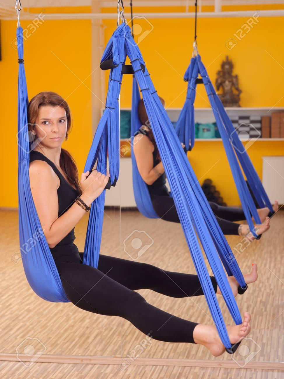 Woman doing anti gravity Aerial yoga exercise Stock Photo - 28227063