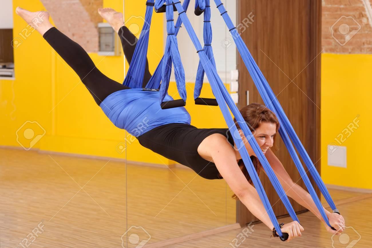 Woman doing anti gravity Aerial yoga exercise Stock Photo - 28227111
