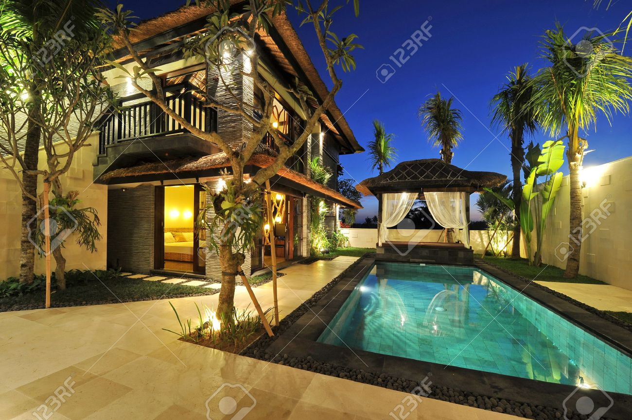 modern tropical villa with swimming pool in nature stock photo