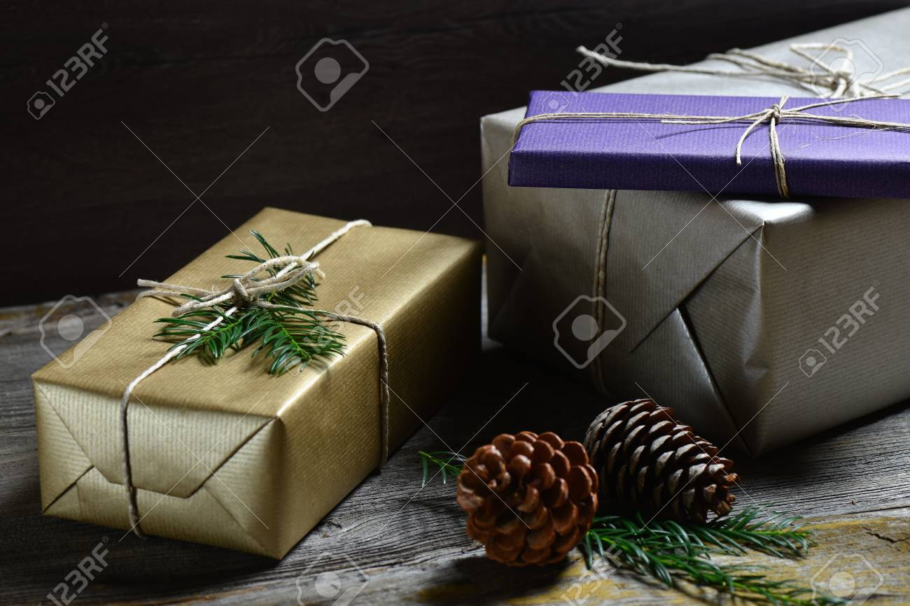 Stylish & Rustic Christmas Gifts Box Presents On The Old Wooden ...