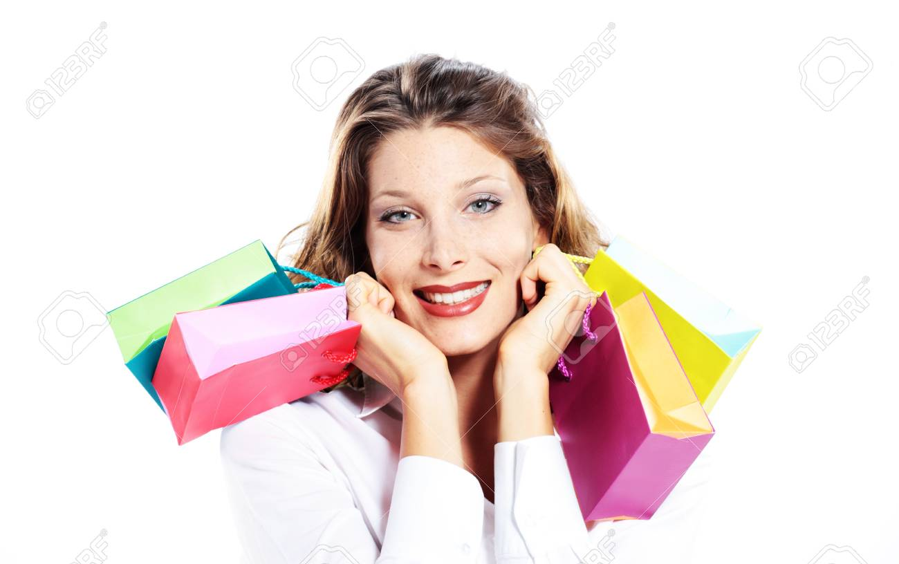 Beautiful shopping woman holding colorful bags, smiling, white background Stock Photo - 10951517