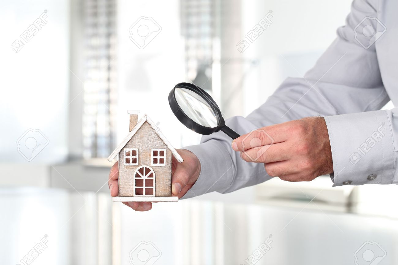 Hands with house, magnifying glass, search home concept - 63956715