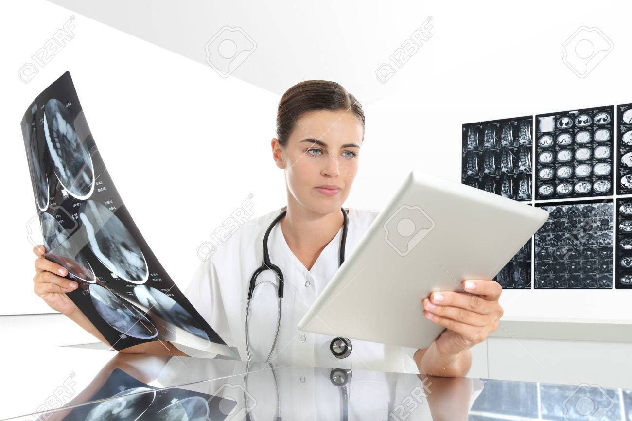 Radiologist Woman Checking Xray With Tablet Medical And Radiology