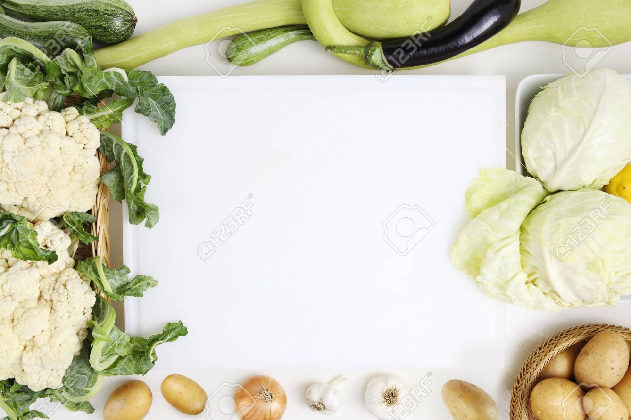 Vegetables Top View White Cutting Board On Kitchen Worktop With