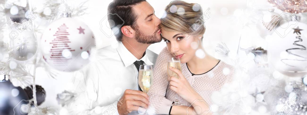 Happy Couple Toasts At Christmas And New Year. Stock Photo, Picture ...