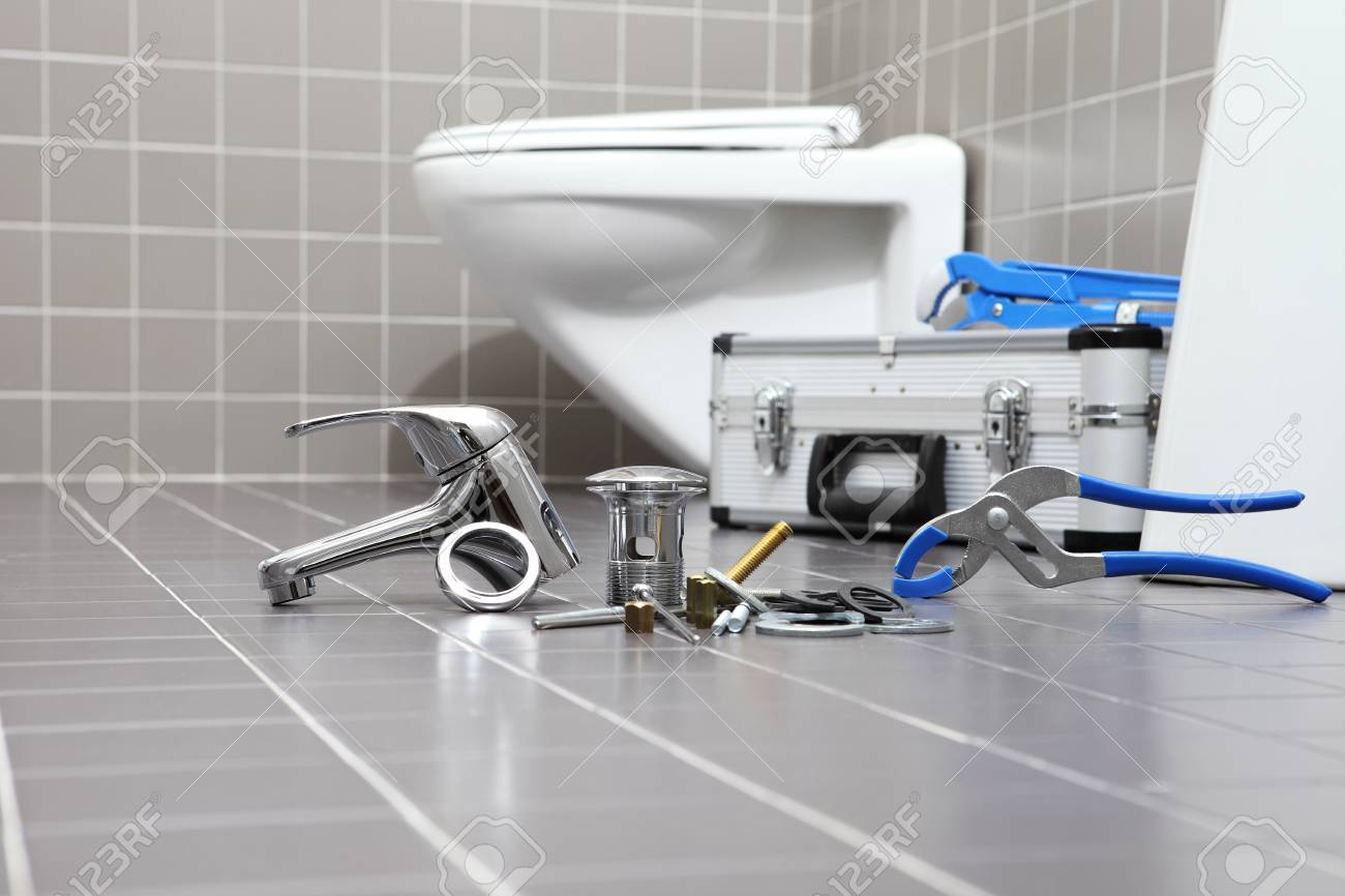 Plumber Tools And Equipment In A Bathroom Plumbing Repair Service - Bathroom repair services