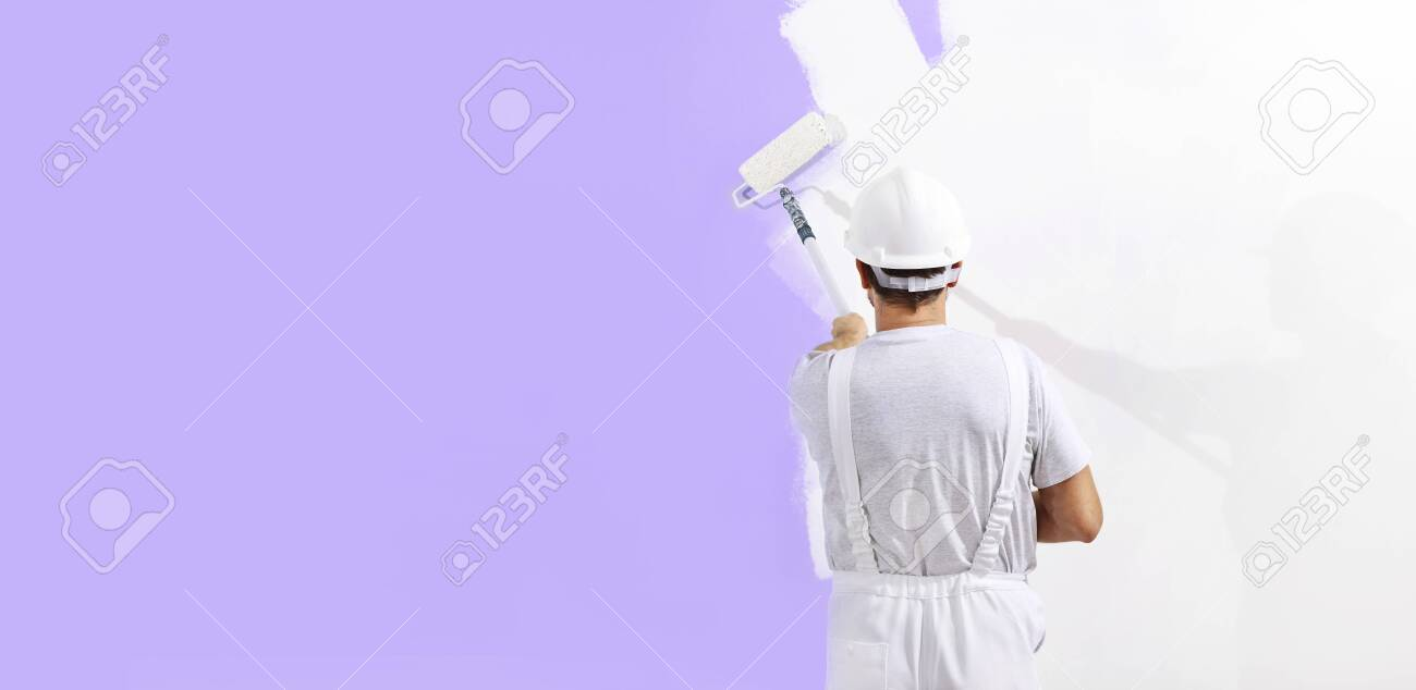 painter man at work with paint roller, wall painting concept, web banner and copy space template. - 119160652