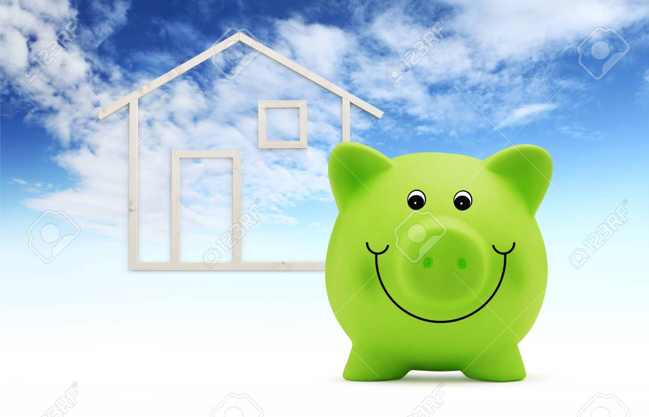 piggy bank with wooden house shape isolated on blue sky background, green building and energy save concept. - 127510679