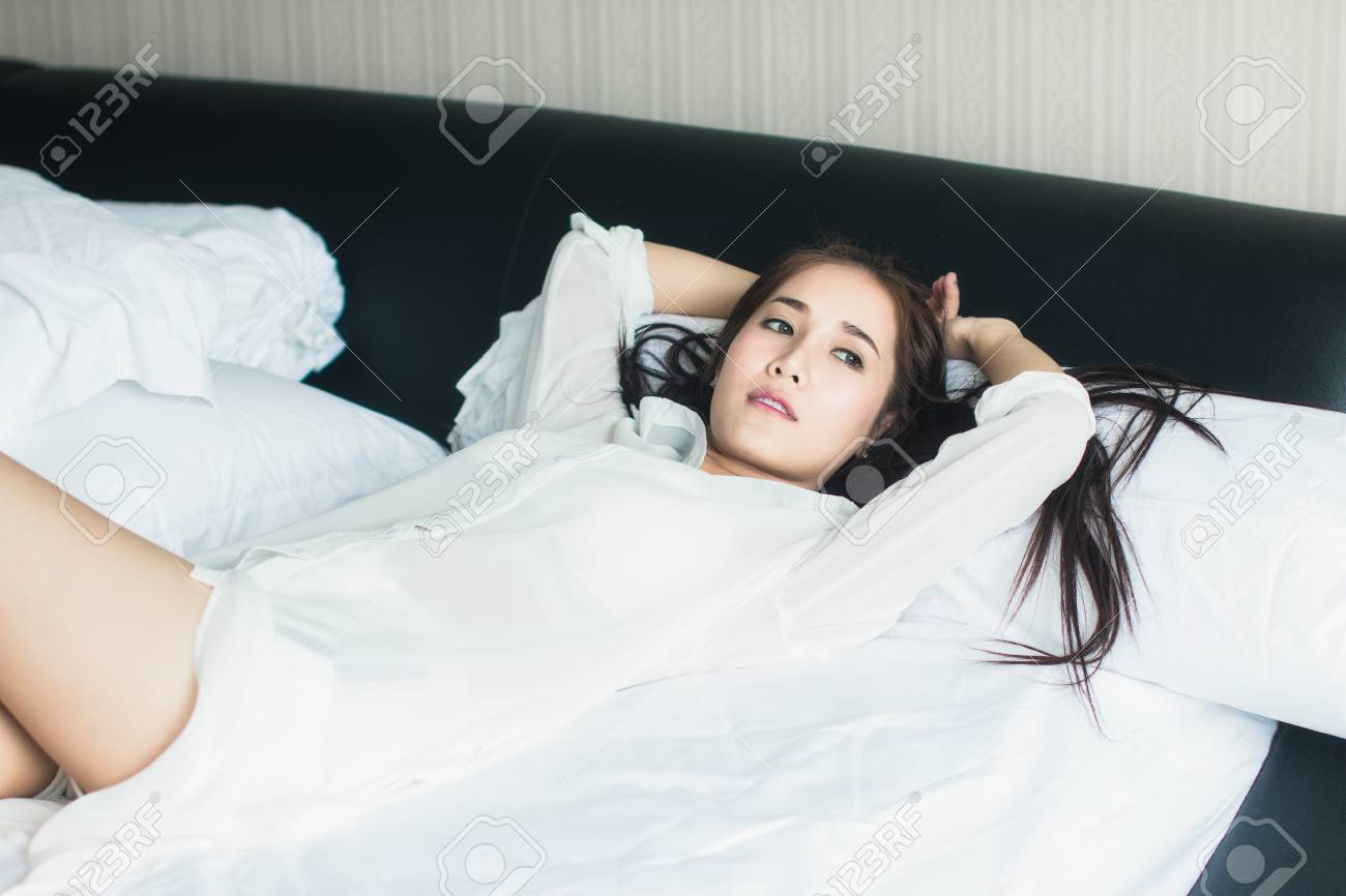 Groovy A Beautiful Asian Girl Wearing White Dress Resting In The Bedroom Home Interior And Landscaping Ologienasavecom
