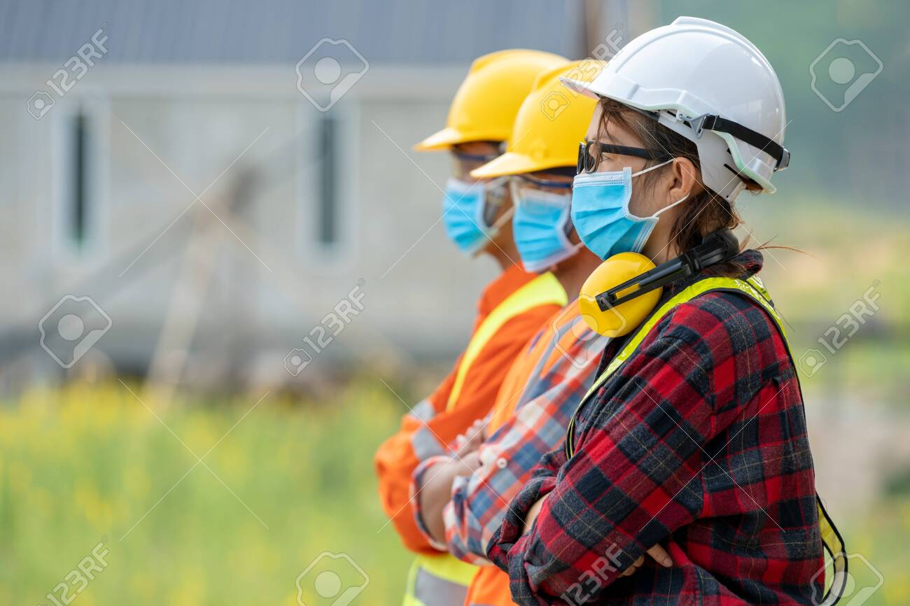 Group of Asian engineers wearing protective mask to Protect Against Covid-19 with helmet safety in the construction site,Coronavirus has turned into a global emergency,Safety concept. - 148583684