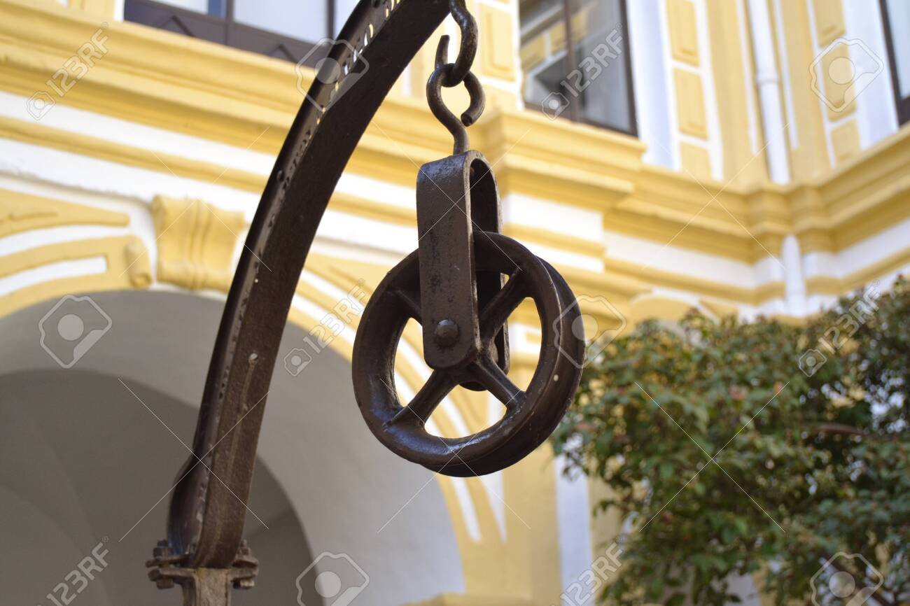 Old Iron Pulley To Draw Water From A Well With A Bucket And Rope Stock Photo Picture And Royalty Free Image Image 120079808