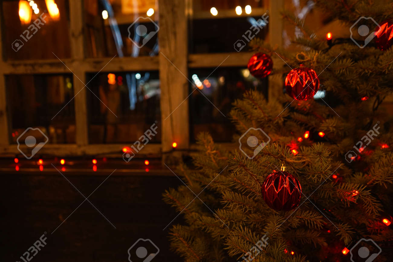 Christmas tree on the background of a wooden window. Close-up. - 159755658