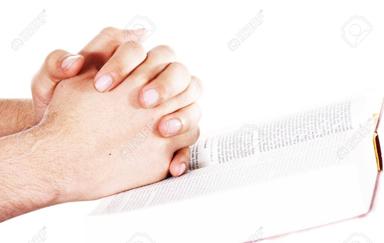 Praying hand hold an open bible Stock Photo - 12922442