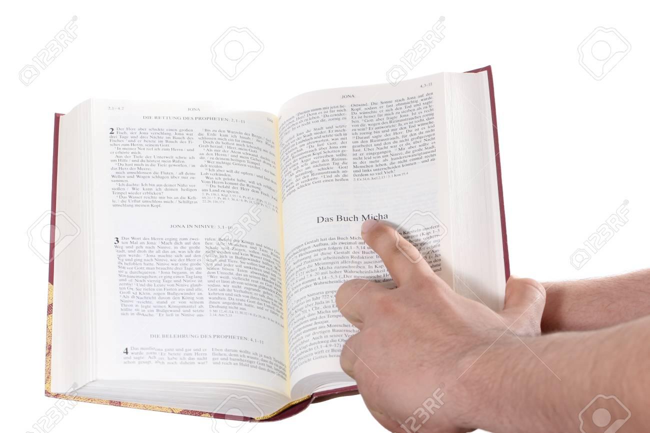 Praying hand hold an open bible