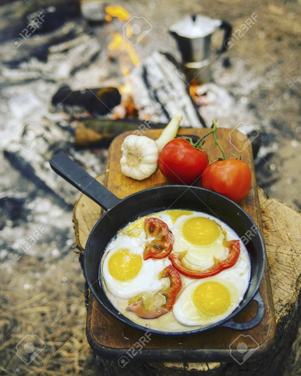Camping In The Forest Preparation Of Breakfast At Stake Stock Photo