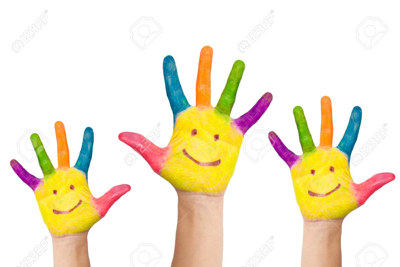 Painted in different colors, with the palms painted smiling faces, a few hands raised up. Greeting or voting approval or teamwork. Stock Photo - 15634386