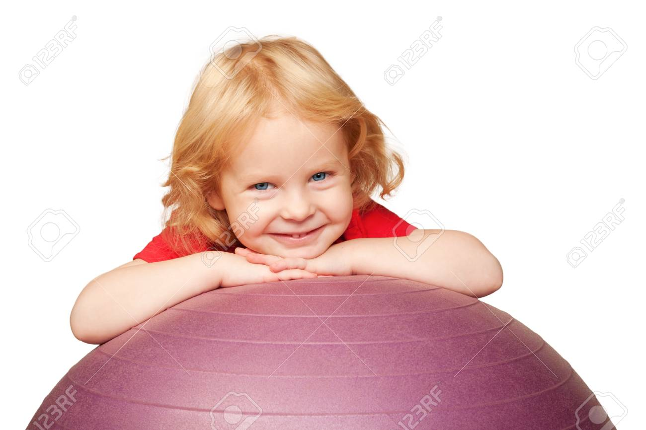 Adorable curly blond baby with blue eyes smiling and playing with fitness ball  Isolated on white background Stock Photo - 16523389