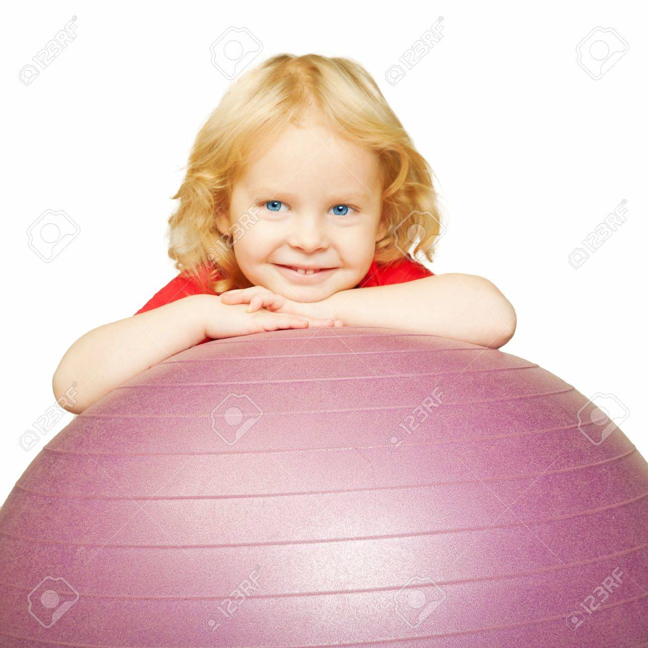 Healthy lifestyle. Child playing sports, smiling and resting on fitball. Isolated on white background Stock Photo - 16686024