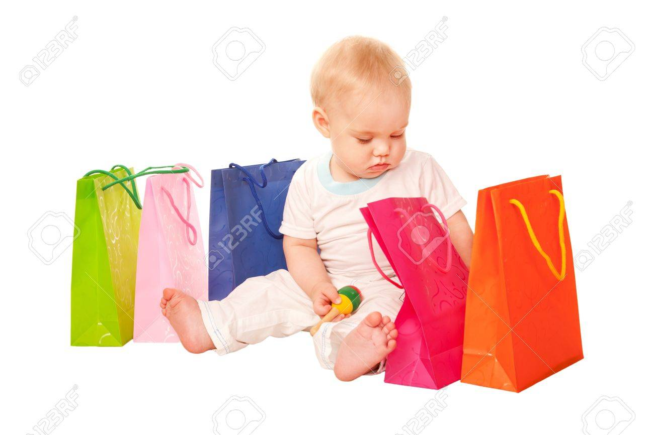 Baby Shopping Happy Child Sitting With Shopping Bags, Examining ...