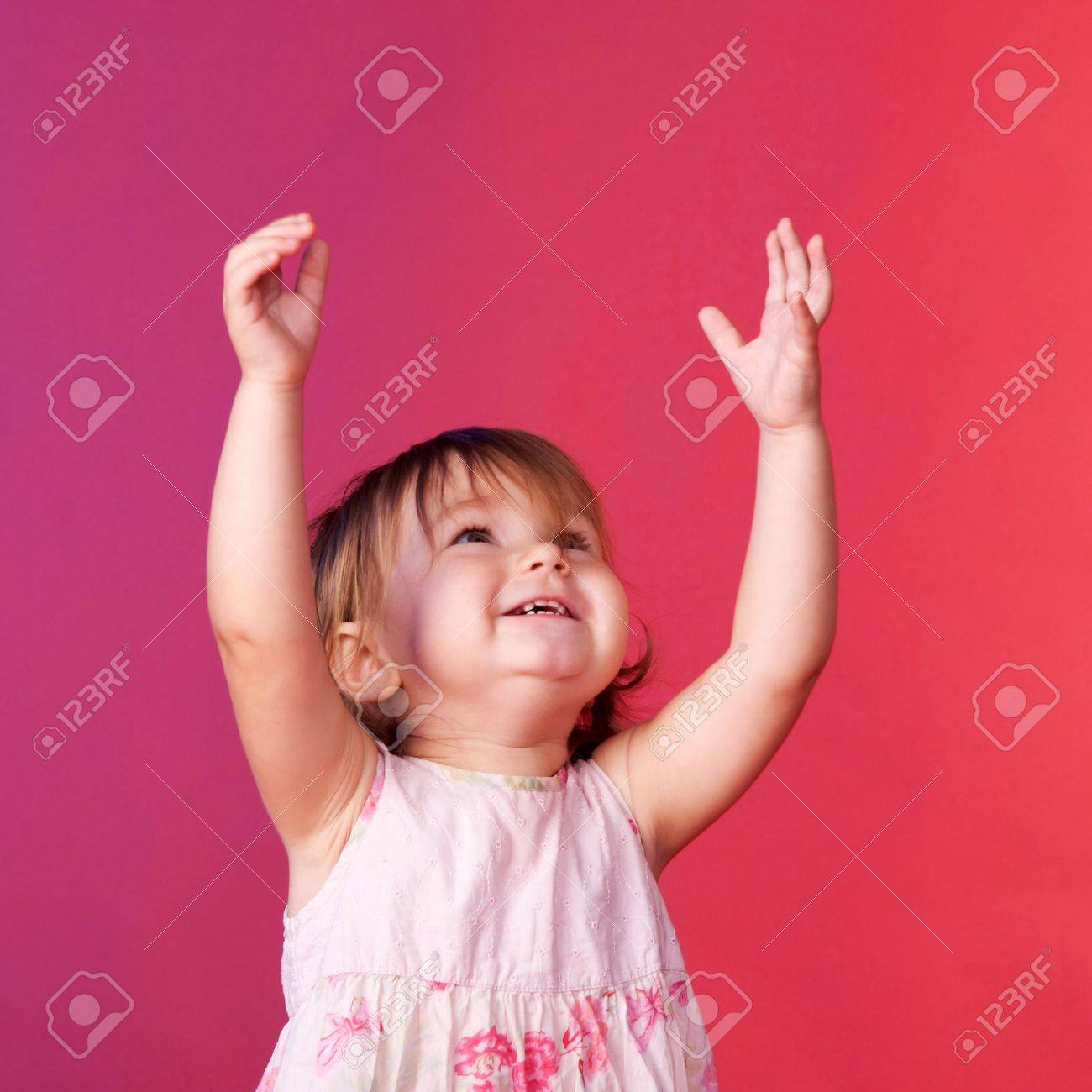 Baby catching something with his hands up. Happy face close up. Stock Photo - 17497765