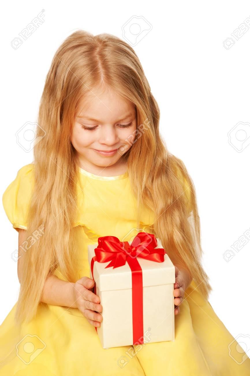 Pretty little girl enjoying gift. Festive concept. Isolated on white background Stock Photo - 18231097