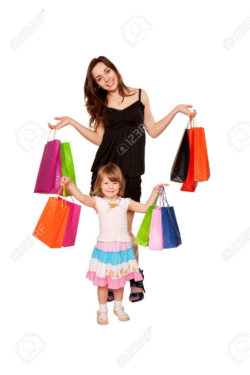 Family Shopping. Two Sisters, A Teenager And A Little Girl Holding ...