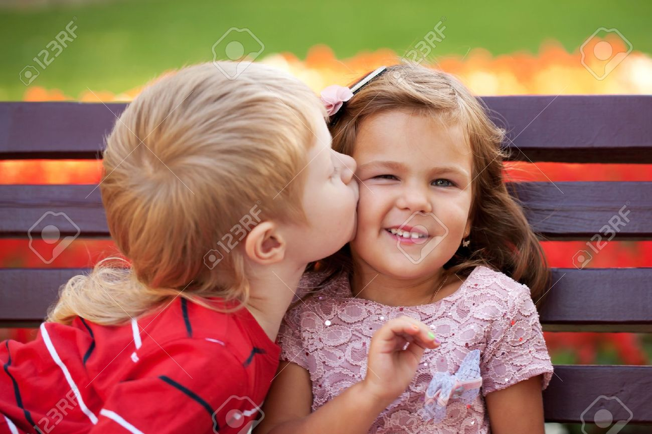 Love concept. Couple of kids loving each other hugging and kissing. Stock Photo - 21575237