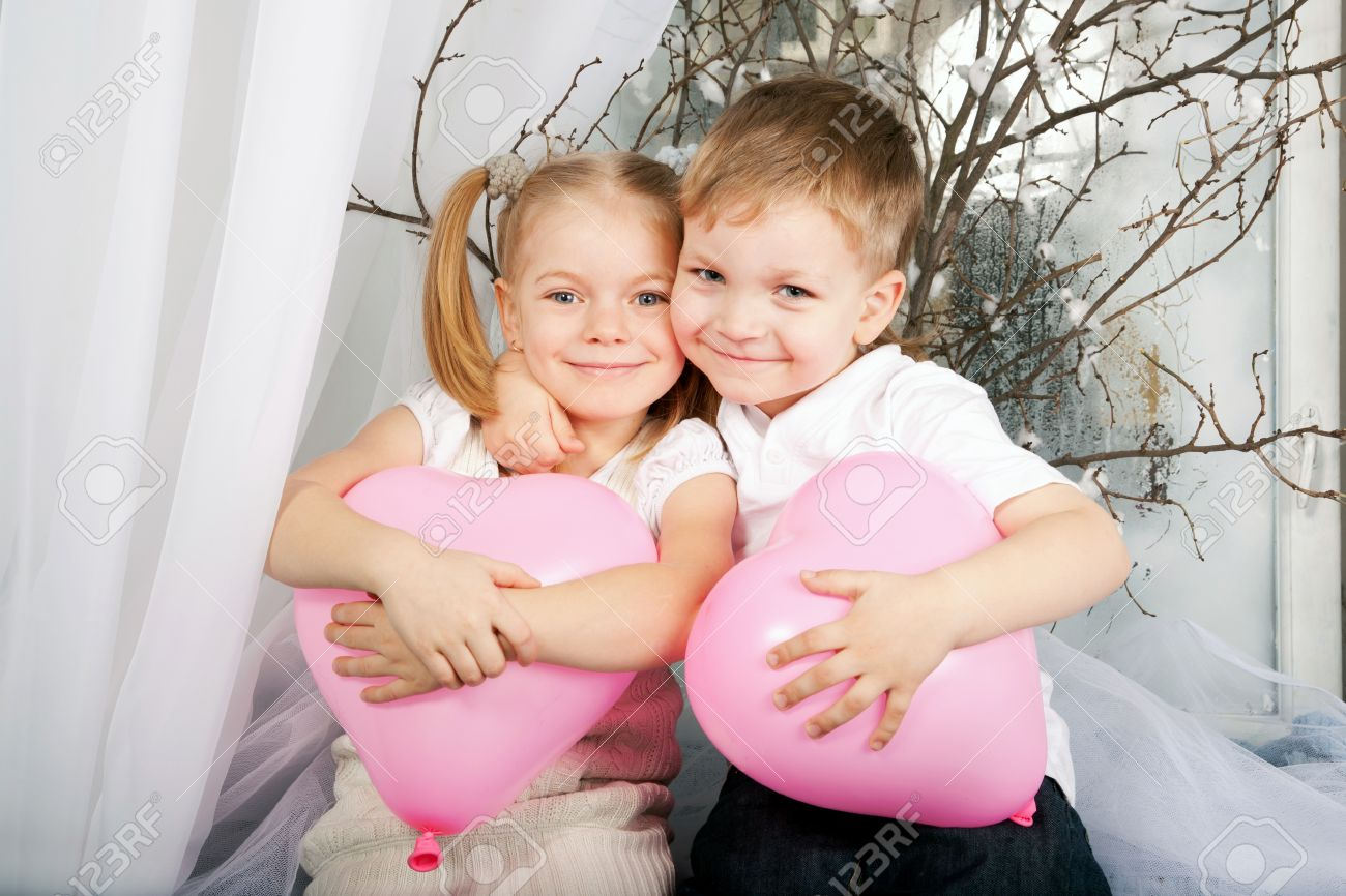 Little Boy And Girl Romantic Couple In Love Little Kids Hugging And Holding Heart Balloons
