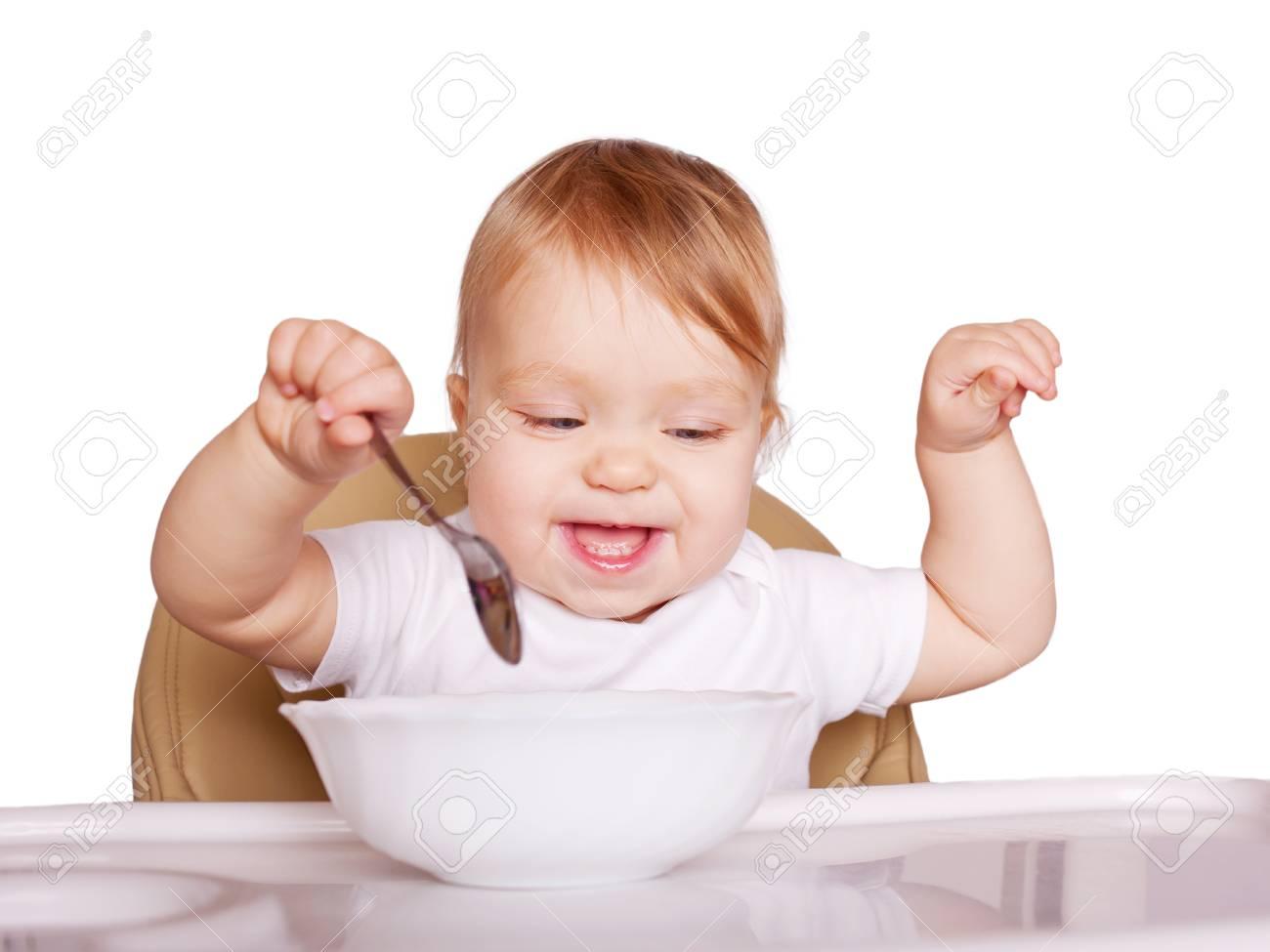 Baby Zitten Stoel.Funny Baby Eten Met Lepel En Zitten In Een Hoge Stoel Voor Het