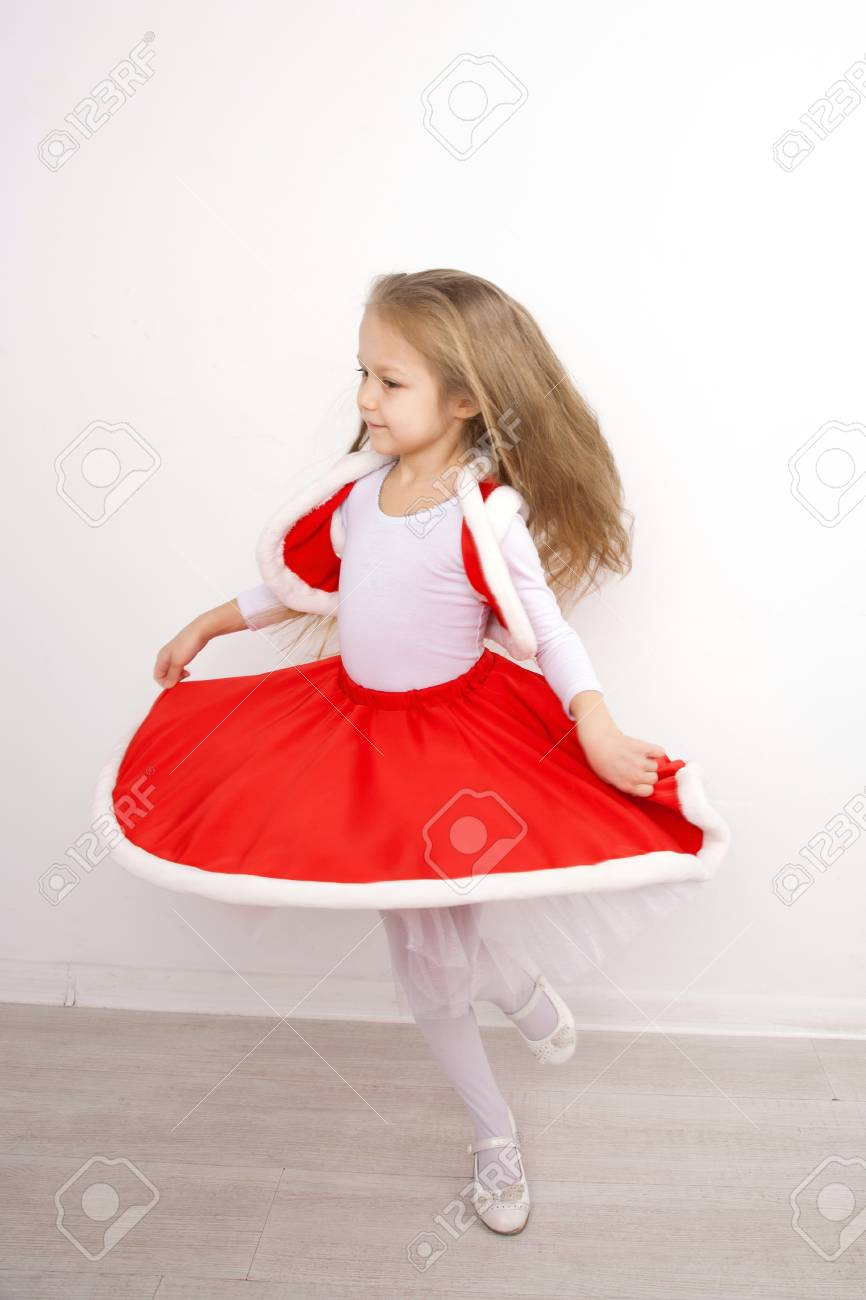 Pretty Little Girl In A Christmas Dress Dancing