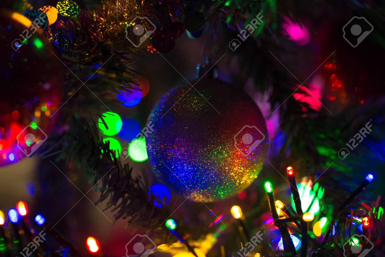 finest selection a27f9 825c9 Multi-colored rainbow Christmas ball hanging on a Christmas tree...